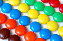 Chocolate Candies. In a row on white background Stock Photography