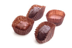 Chocolate Candies 4. Four chocolate candies in paper cups, loose stock photography