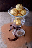 Chocolate candies assortment in glass bowl on Royalty Free Stock Images