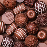 Chocolate candies. Belgian truffles. Background stock image