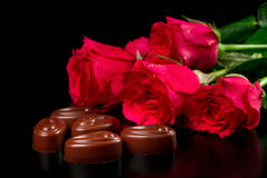 Chocolate candies with a bouquet of roses Royalty Free Stock Photo