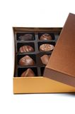 Chocolate Candies Box. Sorted chocolate candies box isolated - focus on upper ones Royalty Free Stock Images