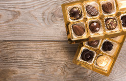 Chocolate candies box. Assorted chocolate candies box on a wooden background Stock Image