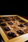 Chocolate candies. A box of chocolates on a black background Royalty Free Stock Image