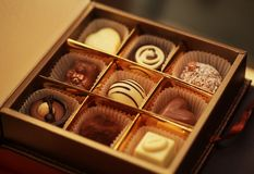 Chocolate candies in a box. Delicious chocolate candies in a box Royalty Free Stock Photos