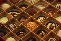 Chocolate candies in a box Stock Photography