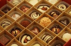 Chocolate candies in a box. Delicious chocolate candies in a box Royalty Free Stock Images