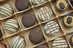 Chocolate candies in a box Stock Images