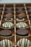 Chocolate candies in a box Stock Photos