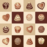 Chocolate candies on a chessboard. Royalty Free Stock Photography