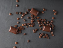 Chocolate candies and coffee beans. On shale board Royalty Free Stock Photography