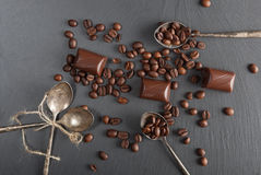 Chocolate candies and coffee beans. On shale board Stock Photo