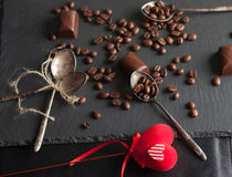 Chocolate candies and coffee beans. On shale board Royalty Free Stock Images