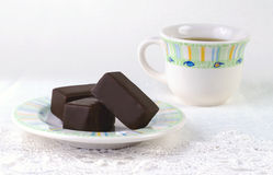 Chocolate candies and cup of coffee on the lace Royalty Free Stock Photos