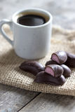 Chocolate candies and cup of coffee Royalty Free Stock Photography