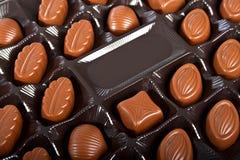 Chocolate candies in dark box. Stock Photo