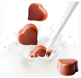 Chocolate candies falling into the milky splash. Vector illustration. Chocolate candies falling into the milky splash Stock Photos