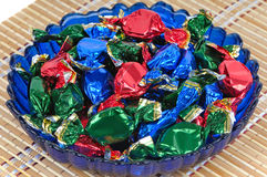 Chocolate candies in a glass blue dish Royalty Free Stock Photography
