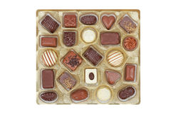 Chocolate candies in a gold box Royalty Free Stock Photography