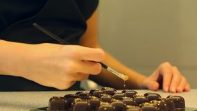 Chocolate candies with gold preapering for sale stock video footage