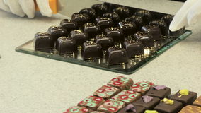 Chocolate candies with gold preapering for sale. In confectionery stock footage