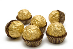 Chocolate candies are in the gold wrapping Royalty Free Stock Photo