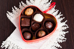 Chocolate candies in heart shape box. Horizontal, close up Stock Image