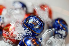 Chocolate candies Lindt Lindor. Candy in multi-colored wraps. Illustrative editorial. Philadelphia, Pennsylvania, November 2017: Chocolate candies Lindt Lindor stock photography