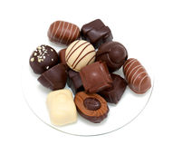 Chocolate candies over white Stock Images