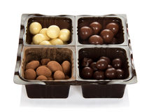 Chocolate candies in plastic container Royalty Free Stock Photo