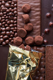 Chocolate candies poured on the background Stock Photo