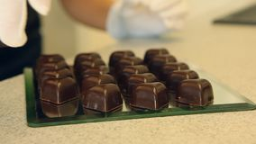 Chocolate candies preapering for sale stock footage