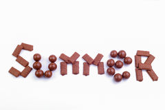 Chocolate candies on a white background. Stock Image
