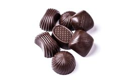 Chocolate candies on a white background. Sweets from dark chocolate on a white background, Different chocolate sweets, Assorted candy, sweets from chocolate royalty free stock images