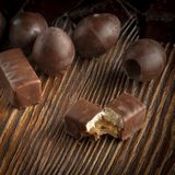 Chocolate candies on a wooden background. Close-up royalty free stock image