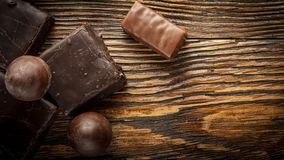 Chocolate candies on a wooden background. Close-up royalty free stock images