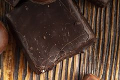 Chocolate candies on a wooden background. Close-up stock photo