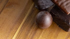 Chocolate candies on a wooden background. Close-up royalty free stock photo