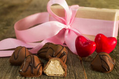 Chocolate candies on a wooden background with a gift box Stock Photo