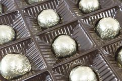 Chocolate candies wrapped  in golden coloured packaging. Chocolate candies wrapped in package Royalty Free Stock Photos