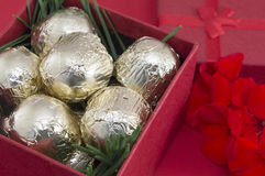 Chocolate candies wrapped  in golden coloured packaging. Chocolate candies wrapped  in golden coloured package Royalty Free Stock Image
