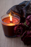 Chocolate Candle and Dry Roses Stock Photo