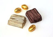 Chocolate candy 1. Candy in foil and golden eggs chocolate Stock Photo