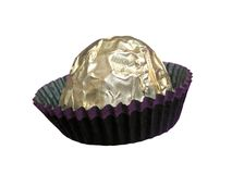 Chocolate candy. In golden wrapper over white background Stock Image