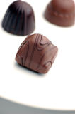 Chocolate candy. On a white plate Stock Photography