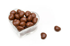 Chocolate candy. In heart shape glass bowl royalty free stock photography