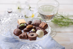 Chocolate candy. Over crystal bowl royalty free stock photo