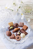 Chocolate candy. Over crystal bowl royalty free stock photos