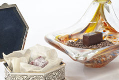 Chocolate Candy. Chocolate candies in glass dish and metal box royalty free stock images