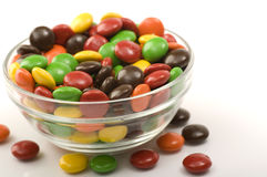Chocolate Candy. In the glass bowl. Shot on white background Royalty Free Stock Photo